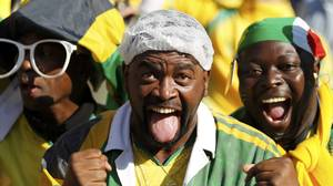 South African soccer fans cheer during the opening ceremony of the 2010 World Cup at Soccer City stadium in Johannesburg.