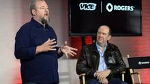 Vice co-founder and CEO Shane Smith, left, gestures as Rogers Communications president and CEO Guy Laurence looks on during an announcement in Toronto on Oct.30, 2014. Rogers is partnering with Vice Media as part of a $100-million joint venture that will create a new TV channel and open a production studio in Toronto. (Nathan Denette/The Canadian Press)