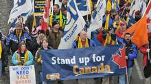 Striking members of the United Steelworkers local 6500 and supporters march in Sudbury, Ont., in January, 2010, to mark the sixth month of their strike against Vale Inco. (Gino Donato/Gino Donato/The Canadian Press)