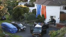 VICTORIA, BC (September 5, 2007) - One of the five bodies is removed from the house at 310 King George Terrace in Oak Bay where five people died in a murder/suicide. (Deddeda Stemler/Deddeda Stemler/The Globe and Mail)