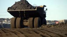 Heavy haulers ply the dirt caked roads at the Syncrude's Mildred Lake oil sands operations north of Fort McMurray , Alberta. (Fred Lum/Fred Lum/The Globe and Mail)