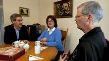 Liberal leader Michael Ignatieff has tea with Helen Hardy and her husband Michael Lemieux, who has cancer, at their home in Gatineau, Que., on Oct. 5, 2010. (Sean Kilpatrick/Sean Kilpatrick/The Canadian Press)