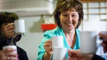 Liberal Leader Christy Clark toasts after serving tea to supporters on a campaign stop at a Korean restaurant in Coquitlam on Wednesday. (DARRYL DYCK/THE CANADIAN PRESS)