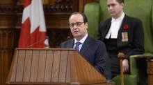 French President Francois Hollande address Parliament in Ottawa on Monday, Nov. 3, 2014. (Sean Kilpatrick/THE CANADIAN PRESS)