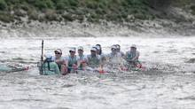 The Cambridge women's boat takes on water during the Boat Race against Oxford on the River Thames in London on Sunday. (Matthew Childs/REUTERS)