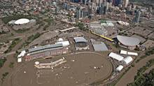 The Bow River overflows its banks into the grounds of the Calgary Stampede and Saddledome hockey arena on June 22, 2013. (ANDY CLARK/REUTERS)