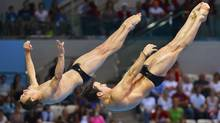 Canada's Alexandre Despatie, right, and Reuben Ross perform a dive during the men's synchronised 3m springboard final at the London 2012 Olympic Games at the Aquatics Centre August 1, 2012. (Reuters)