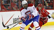 Montreal Canadiens' P.K. Subban controls the puck as Carolina Hurricanes' Eric Staal (12) chases during the first period of an NHL hockey game in Raleigh, N.C., Thursday, April 5, 2012. (Associated Press)