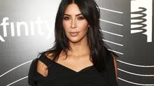 Kim Kardashian, seen here in May in New York, was recently robbed at gunpoint in Paris after posting photos there all week, including a snap on Instagram of a diamond ring that may now be stolen. (Andy Kropa/AP)