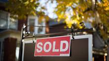 A real estate sold sign hangs in front of a west-end Toronto property Friday, Nov. 4, 2016. THE CANADIAN PRESS/Graeme Roy (Graeme Roy/THE CANADIAN PRESS)