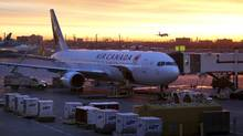An Air Canada airplane is prepared at dawn for boarding at Pearson International Airport in Toronto. (CHRIS HELGREN/REUTERS)