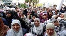 Supporters of the Islamist Ennahda movement chant slogans during campaign manager of the Ennahda party, Abdelhamid Jlazzi's speech outside the party's headquarters in Tunis October 24, 2011. (ZOUBEIR SOUISSI/ZOUBEIR SOUISSI/REUTERS)