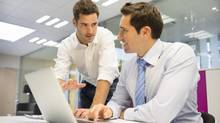 Two handsome businessmen working together on computer (LDProd/Getty Images/iStockphoto)