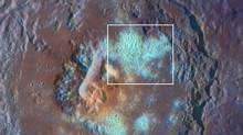 Undated NASA Messenger probe images obtained on September 29, 2011, shows a large crater with a floor partially covered by large numbers of Coalesced Hollows. Mercury may have a lot in common with Earth, but close-up images and data captured by NASA'S MESSENGER probe this year show it's still a bit of a planetary weirdo. (NASA/REUTERS/NASA/Handout)