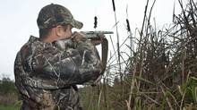 A hunter takes aim on his property near Fenelon Falls, Ont, on Octo 25, 2011. (FRED THORNHILL/FRED THORNHILL FOR GLOBE AND MAI)