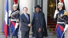 "French President Francois Hollande, left, poses with Nigeria President Goodluck Jonathan upon his arrival for the ""Paris' Security in Nigeria summit,"" at the Elysee Palace, in Paris, Saturday, May 17, 2014. Leaders from Africa as well as officials from the United States, Britain and France meet to coordinate a response to Boko Haram, the fundamentalist group that abducted more than 300 girls and is accused of hundreds of deaths in the past year alone. (Francois Mori/AP)"