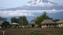 FILE PHOTO: Houses are seen at the foot of Mount Kilimanjaro in Tanzania's Hie district December 10, 2009. (Katrina Manson/Reuters)