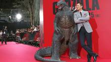 Actor Ken Watanabe poses at Japanese premiere of Godzilla in Tokyo on Thursday. The rebooted film is finally set to open in the country July 25 after earning $488-million worldwide. (Shizuo Kambayashi/AP)