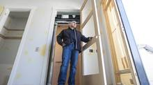 Domenico Daprocida stands inside the doorway of his residential elevator inside his custom built home in Calgary, Alberta on March 05, 2013. (Chris Bolin for The Globe and Mail)