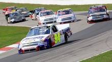 Chase Elliott leads a pack of trucks during the NASCAR Camping World Truck Series Chevrolet Silverado 250 at Canadian Tire Motorsport Park on September 1, 2013 in Bowmanville, Ontario. (NASCAR)