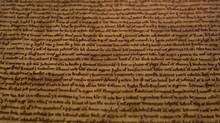 A detail of the Salisbury Magna Carta, one of the four original surviving Magna Carta manuscripts, is on display at the British Library in London on Feb. 2, 2015. (ALASTAIR GRANT/ASSOCIATED PRESS)