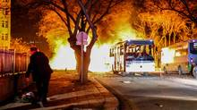 Turkish army service buses burn after a deadly explosion on Wednesday in Ankara. (Defne Karadeniz/Getty Images)