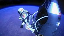 In this Oct. 14, 2012 file photo provided by Red Bull Stratos, pilot Felix Baumgartner of Austria jumps out of the capsule during the final manned flight for Red Bull Stratos. In a giant leap from more than 24 miles up, Mr. Baumgartner shattered the sound barrier while making the highest jump ever with a tumbling, death-defying plunge from a balloon to a safe landing in the New Mexico desert. (Uncredited/AP)
