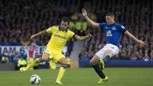 Everton's James McCarthy, right, fights for the ball against Chelsea's Cesc Fabregas during their English Premier League soccer match at Goodison Park Stadium, Liverpool, England, Saturday Aug. 30, 2014 (Jon Super/Associated Press)