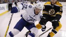 Jonathan Drouin and Brandon Carlo battle along the boards during the first period of an NHL hockey game in Boston, Sunday, Nov. 27, 2016. (Michael Dwyer/The Associated Press)