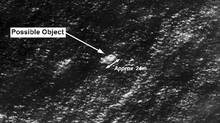 Satellite imagery provided to Australian Maritime Safety Authority (AMSA) of objects that may be possible debris of the missing Malaysia Airlines Flight MH370 in a revised area 185 km to the south east of the original search area in this picture released by AMSA March 20, 2014. (REUTERS/Australian Maritime Safety Authority/Handout)