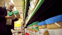Chuck Nascimento shops for peanut butter at the Heartland Wal-Mart in Mississauga. (JENNIFER ROBERTS/JENNIFER ROBERTS For The Globe and Mail)