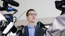 Progressive Conservative candidate Sam Oosterhoff speaks to the media after casting his vote in Vineland, Ont., on Nov. 17, 2016. (Aaron Lynett/THE CANADIAN PRESS)