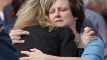 Roxanne Priede (right), mother of Master Cpl. Darrell Priede, comforts her daughter-in-law Angela Priede as the soldier's casket arrives back in Canada during a repatriation ceremony at CFB Trenton, Monday June 4, 2007. (Adrian Wyld/THE CANADIAN PRESS)