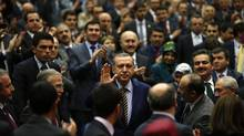 Turkey's Prime Minister Recep Tayyip Erdogan greets members of his ruling party at AKP headquarters on Dec. 25. (UMIT BEKTAS/REUTERS)