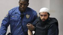 In this Dec. 20, 2016, file photo, Ahmad Khan Rahimi is led into court in Elizabeth, N.J. Rahimi has asked a judge to move his trial to Vermont. (Mel Evans/AP)