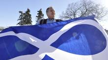 File photo of Manitoba Métis Federation president David Chartrand with the Métis Infinity Flag. (Robert Tinker For The Globe and Mail)