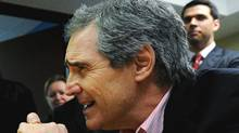 Liberal leader Michael Ignatieff, right, reacts while talking with people at the Carrefour Communautaire de Charlesbourg during a campaign stop in Quebec City, on Tuesday, April 5, 2011. (Nathan Denette/THE CANADIAN PRESS)