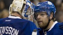 Toronto Maple Leafs right winger Phil Kessel (right) congratulates goaltender Jonas Gustavsson after they defeated the Detroit Red Wings 4-3 in NHL action in Toronto on Saturday January 7, 2012. THE CANADIAN PRESS/Frank Gunn (Frank Gunn)