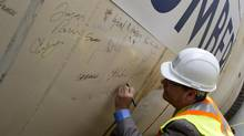 Bruce McCuaig, CEO of Metrolinx, signs one of the tunnel-boring machines in Toronto, Ont. Wednesday, June 5, 2013. Metrolinx used public funds to pay for a sponsorship deal with the Toronto International Film Festival in 2011, The Toronto Sun discovered. (Kevin Van Paassen/The Globe and Mail)