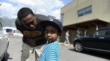 Samuel Andemariam and his three year old son Amar'e are photographed outside a Toronto City Kid's Child Care Centre at 34 Bathurst St. on July 4 2012. Amar'e has been going to this particular daycare since he was 8 months old even though his family lives in another part of the city. A Toronto councillor is proposing getting out of running child care centres and getting the province or school boards to manage them as a means to save money. (Fred Lum/The Globe and Mail)