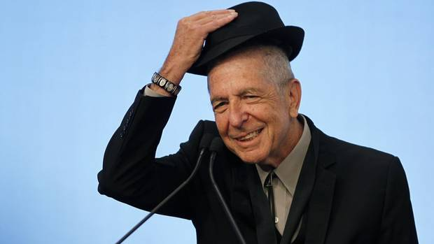 Musician Leonard Cohen tips his hat to the audience as he accepts the 2012 Awards for Song Lyrics of Literary Excellence, which was awarded to both he and Chuck Berry at the John F. Kennedy Presidential Library and Museum, in Boston, Massachusetts, U.S. on February 26, 2012.