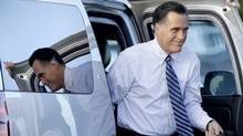 Republican presidential candidate Mitt Romney prepares to board his campaign plane in West Palm Beach, Fla, Oct. 23, 2012, after his final presidential debate with President Barack Obama. (David Goldman/AP PHTO)