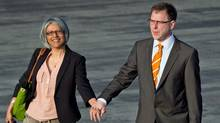 B.C. NDP Leader Adrian Dix, right, and his wife Renee Saklikar walk across the tarmac to board a flight in Richmond, B.C., on May 3, 2013. (Darryl Dyck/The Canadian Press)