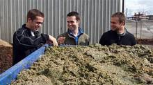 EcoScraps (L-R) co-founder Craig Martineau, co-founder Dan Blake and former colleague Brandon Sargent look at mulched food at the EcoScraps facility in Salt Lake City, Utah, in this handout photo taken in 2011 (Reuters Handout)