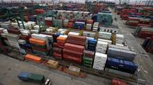 Piles of containers at Waigaoqiao Container Port are seen in Shanghai, China. (Eugene Hoshiko/AP/Eugene Hoshiko/AP)