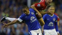Everton's Steven Pienaar (L) challenges Manchester United's Tom Cleverley during their English Premier League soccer match at Goodison Park in Liverpool, northern England, Aug. 20, 2012. Billionaire money manager George Soros reported a nearly 2-per-cent stake in Manchester United PLC on Monday. (PHIL NOBLE/REUTERS)