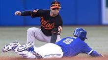 Toronto Blue Jays' Anthony Gose is caught stealing second by Baltimore Orioles' Brian Roberts during fifth inning AL baseball action in Toronto on Saturday September 14, 2013. (CHRIS YOUNG/THE CANADIAN PRESS)