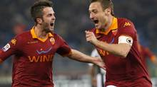 AS Roma's Francesco Totti (R) celebrates with teammate Miralem Pjanic after scoring against Juventus during their Italian Serie A soccer match at the Olympic stadium in Rome February 16, 2013. (STEFANO RELLANDINI/REUTERS)