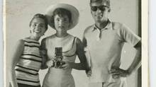 This undated photo provided by John McInnis Auctioneers in Amesbury, Mass., shows late President John F. Kennedy, right, with his wife, Jacqueline, centre, and sister-in-law Ethel Kennedy. (Matthew Bourgeois/AP)
