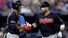 Jason Kipnis celebrates with his teammate Francisco Lindor after hitting a solo home run in the sixth inning against Marcus Stroman. (Elsa/Getty Images)